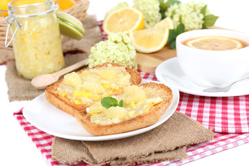 Delicious toasts with lemon jam on plate on table close-up