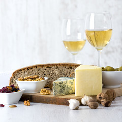 White Wine, cheese, nuts, olives, dried fruit, bread and garlic