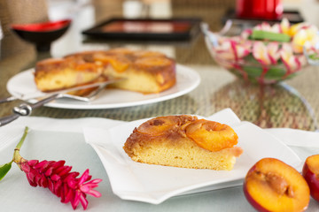Slice of plum cake on square plate