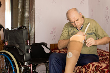 Elderly man checking out his artificial leg