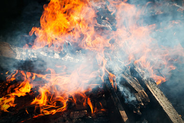 Closeup photo of big outdoor bonfire with smoke