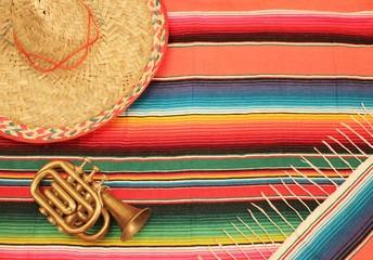 Mexican poncho sombrero poncho with mariachi trumpet sombrero cinco de mayo background mexico fiesta copy space pattern stripes copy space serape stock, photo, photograph, picture, image,