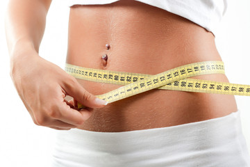 Woman measuring belly after diet