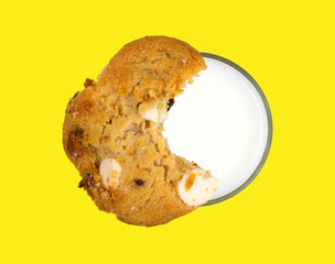 Cookie atop glass of skim milk
