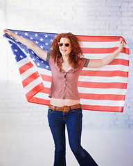Hippie girl holding USA flag