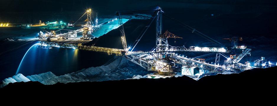 machine in an open coal mine at night