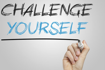Challenge yourself written on a whiteboard