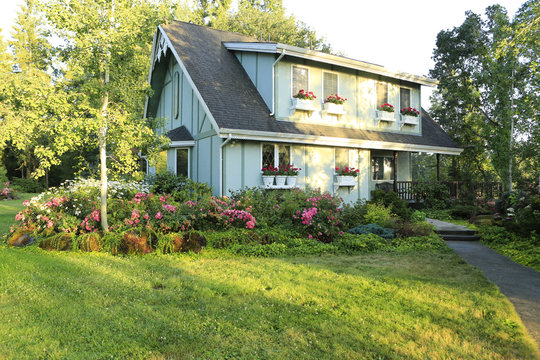 Big farmhouse with beautiful flowerbed