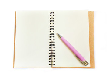 Notebook and pink pen on white background