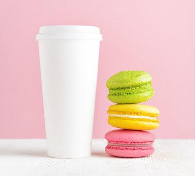 Macaron and tumbler of coffee