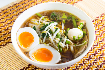 Thai noodle with meatball and boiled egg