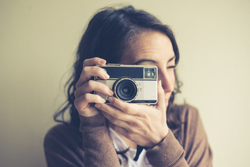 beautiful woman holding old camera