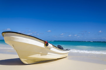Amazing boat on Sandy Tropical Caribbean Beach