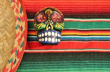 cinco de mayo Mexican sombrero poncho serape stripe background candy skull sombrero fiesta stock photo photograph image