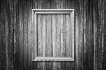 Fototapete - Old picture frame on wooden wall