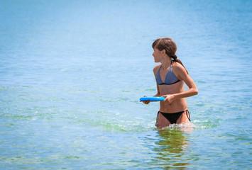 sports girl in the sea
