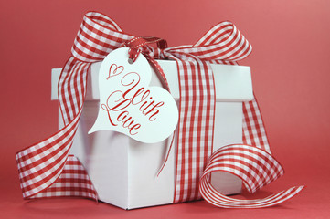 Red and white check gift on red background