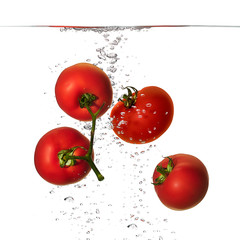 Fresh Red Tomatoes in Water Isolated on White Background
