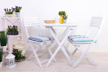 Garden chairs and table with flowers