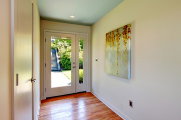 Brightt hallway with glass entrance  door