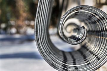 Spiral steel rods form on blur background