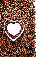 Roasted Coffee Beans with Heart Shaped Paper Sticker over coffee