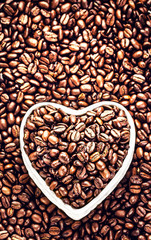 Roasted Coffee Beans in a Heart shaped  bowl at Valentine Day Ho