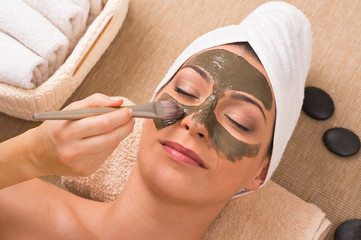 Woman With Green Clay Mask At Spa
