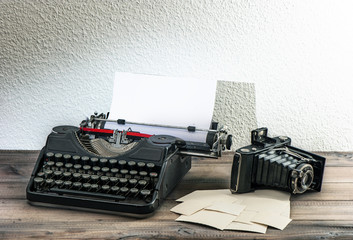 old typewriter and vintage photo camera. antique objects