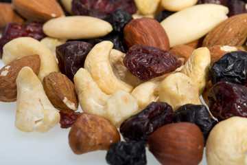 mixed nuts and dried fruits isolated on white background