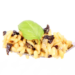 Risotto with mushrooms on a fork on a white background
