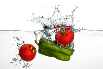 Fresh Tomatoes and Green Pepper Splash in Water Isolated on Whit