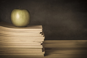 Teacher's Desk - Apple on Books