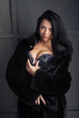 Photo of  beautiful woman in lingerie , coat,fur