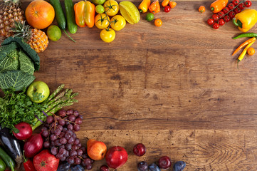 Healthy eating background. Studio photography of different fruits and vegetables on old wooden table