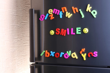 Word Smile spelled out using colorful magnetic letters