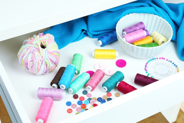Sewing accessories in open drawer close up
