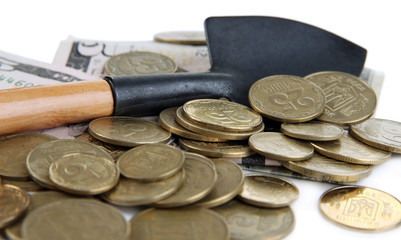 Money with shovel close up