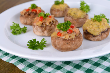 Stuffed mushrooms on plate on table close-up