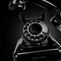 Black vintage phone on the dark background