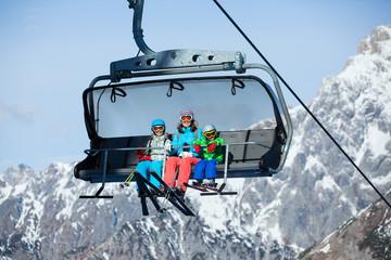 Skiers on a ski lift.