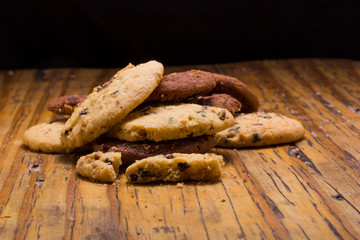 Stack of Chocolate chip cookies on wooden background.