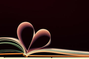 Book pages shaped as a valentines heart