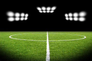 Green soccer field, bright spotlights,