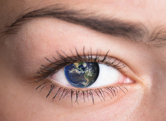 Eye with the earth. Elements of this image furnished by NASA.