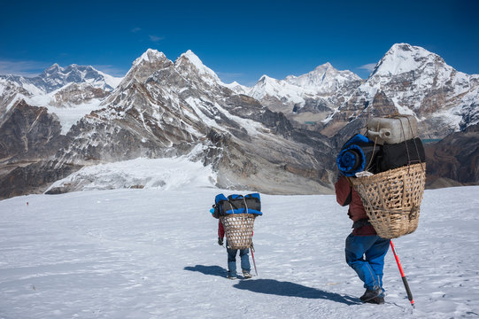Porter carrying heavy loads in Himalayas of Nepal