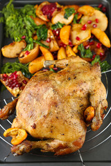 Whole roasted chicken with vegetables and fried potatoes
