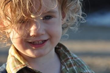 Smiling Boy with Blonde Wispy Hair