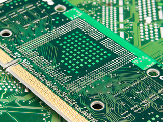 Microchip processor on green pcb motherboard