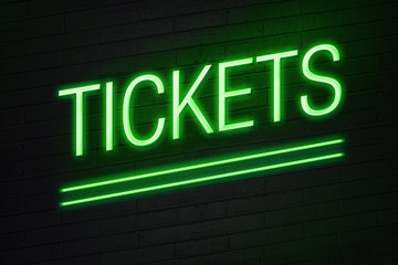 Tickets neon sign on wall